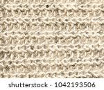 knitted fabric of yarn of cream ... | Shutterstock . vector #1042193506