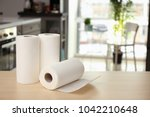 rolls of paper towels on table... | Shutterstock . vector #1042210648