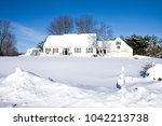 house snowed in after blizzard | Shutterstock . vector #1042213738