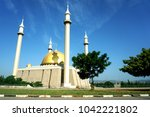 photo focus on the mosque.... | Shutterstock . vector #1042221802