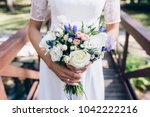 the bride is holding a wedding... | Shutterstock . vector #1042222216