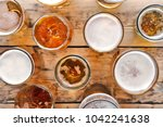 glassware with fresh beer on...   Shutterstock . vector #1042241638
