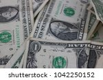 close up of old one dollar bills | Shutterstock . vector #1042250152