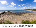 beautiful day at the beach in... | Shutterstock . vector #1042255432