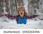a little boy is standing in a... | Shutterstock . vector #1042263346