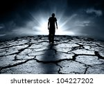 A depressed teenager walking towards the light - stock photo