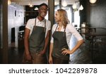 happy young coffee shop owners... | Shutterstock . vector #1042289878