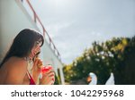 smiling woman having a cocktail ... | Shutterstock . vector #1042295968