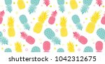 vector colorful pineapples... | Shutterstock .eps vector #1042312675