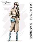 fashion woman in stylish coat.... | Shutterstock .eps vector #1042341145