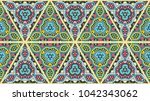 colorful seamless triangle... | Shutterstock .eps vector #1042343062