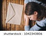 the little girl tiredly put her ... | Shutterstock . vector #1042343806