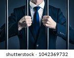 businessman and prison | Shutterstock . vector #1042369732