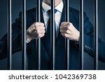 businessman and prison | Shutterstock . vector #1042369738