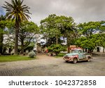 a vintage car in colonia ... | Shutterstock . vector #1042372858