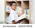 asian student is searching for... | Shutterstock . vector #1042374958