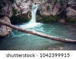 A Small Mountain Waterfall In...