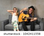 man singing out of tune ... | Shutterstock . vector #1042411558