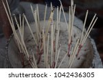 closed up incense stick in joss ... | Shutterstock . vector #1042436305