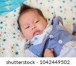 infant baby boy in suit lying... | Shutterstock . vector #1042449502