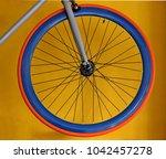 carbon blue wheel with orange... | Shutterstock . vector #1042457278