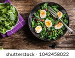 fresh spinach salad with eggs... | Shutterstock . vector #1042458022