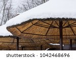 view of straw parasols ... | Shutterstock . vector #1042468696
