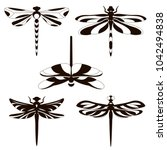Stock vector set of silhouettes of dragonflies 1042494838