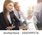 business woman with a colleague ... | Shutterstock . vector #1042499176
