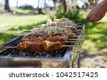 fry meat in the nature with a... | Shutterstock . vector #1042517425