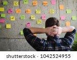 back of entrepreneur sitting in ... | Shutterstock . vector #1042524955