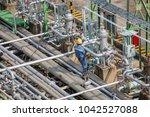 male worker inspection visual... | Shutterstock . vector #1042527088