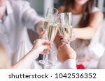friends in restaurant having a...   Shutterstock . vector #1042536352