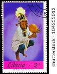 LIBERIA - CIRCA 1967: A stamp printed in Liberia shows African Rattle series Local Music, circa 1967 - stock photo