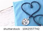a stethoscope shaping a heart... | Shutterstock . vector #1042557742