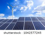 solar panels and wind turbine... | Shutterstock . vector #1042577245