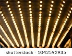 rows of illuminated globes... | Shutterstock . vector #1042592935