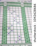 Small photo of Students answer sheet with choices marked with crosses inside the squares of a multiple choice test paper