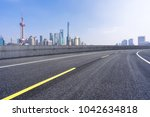 empty road with moden building... | Shutterstock . vector #1042634818