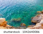 divers in the greek sea | Shutterstock . vector #1042640086