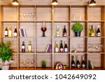 wooden cupboard with wine ... | Shutterstock . vector #1042649092