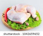 raw chicken legs on a white... | Shutterstock . vector #1042659652