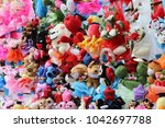many colorful toy dolls... | Shutterstock . vector #1042697788
