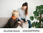 a young girl explains to an...   Shutterstock . vector #1042699096
