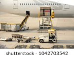 loading luggage on the plane ... | Shutterstock . vector #1042703542