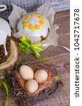 eater cakes with egg decoration ... | Shutterstock . vector #1042717678