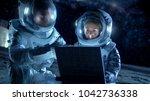 two astronauts wearing space...   Shutterstock . vector #1042736338