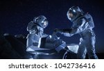 two astronauts in space suits... | Shutterstock . vector #1042736416