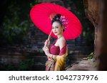 beautiful thai girl in... | Shutterstock . vector #1042737976