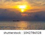 sunrise  fisherman in his boat... | Shutterstock . vector #1042786528